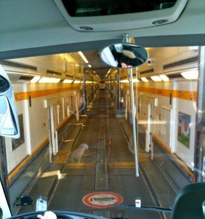 Inside the shuttle. (Once we load, they shut the individual walls to create smaller compartments.)