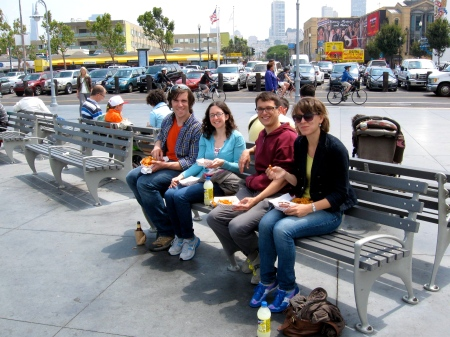 By the Fisherman's Wharf eating low-grade greasy food