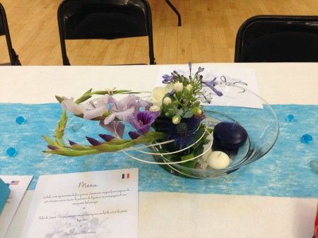 Our table flower arrangement + the menu in French