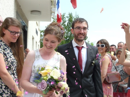 Coming out of the mairie, getting whacked with petals (photo by J's sister)